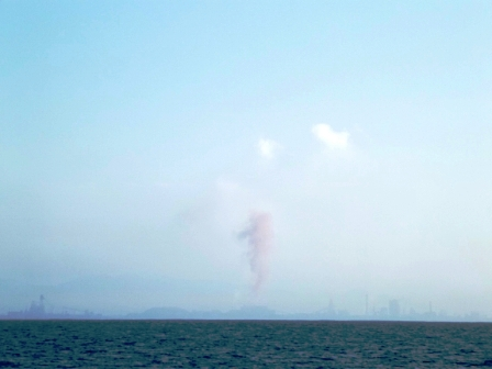Notice the red plume of smoke coming from the stacks...It was only a short burst, can't be that bad.